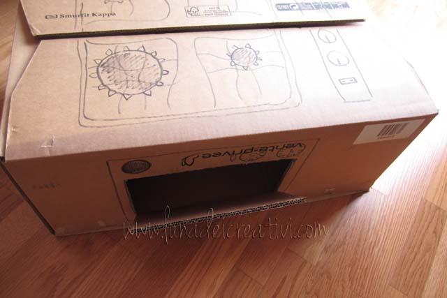 Paso 3 - Para el horno, con el cuter abre una pequeña puerta en el lado de la caja.